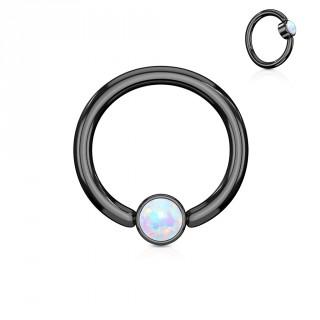 Anneau noir à cylindre captif serti d'une opale blanche