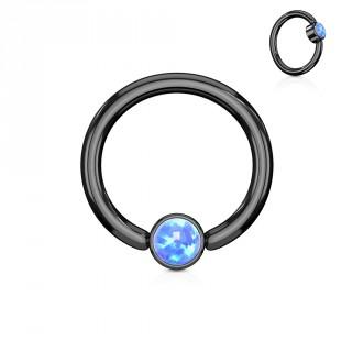 Anneau noir à cylindre captif serti d'une opale bleue