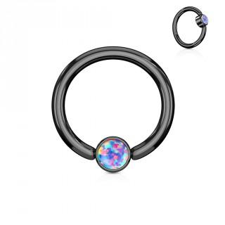 Anneau noir à cylindre captif serti d'une opale violette