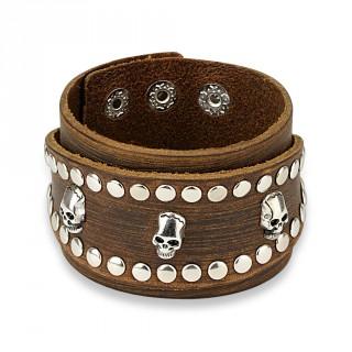 Bracelet en cuir marron aspect usé à bande ovale rivetée avec inserts tête de mort