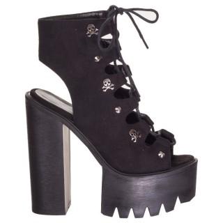 Chaussures compensées noires à cranes modèle Lucille - Banned