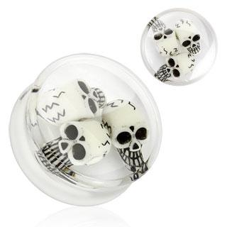 Piercing plug transparent renfermant des têtes de morts