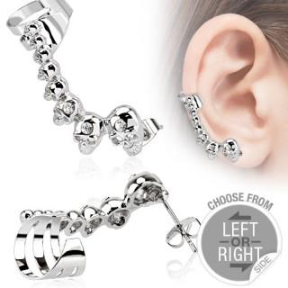 Piercing tour d'oreille avec têtes de morts serties